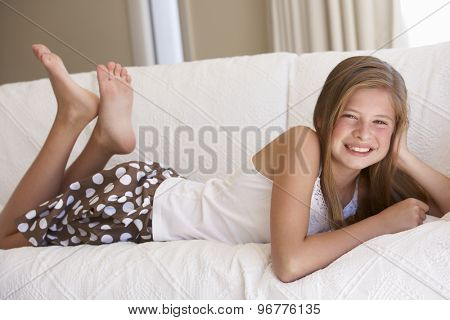 Young Girl Relaxing On Sofa At Home