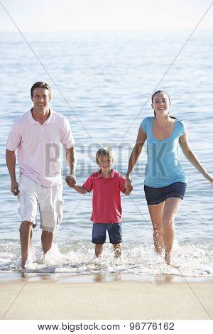 Running Family On Beach Holiday