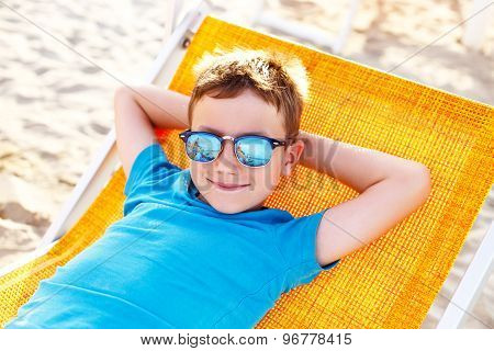 Little Boy Relax On Deckchair