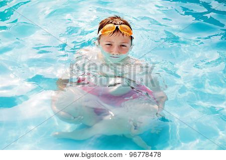 Little Boy With Magnified Body In Water Refraction