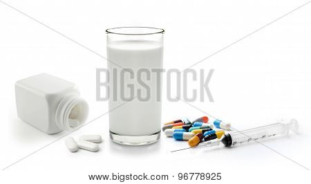 Pill And Glass Of Milk Isolated On White Background