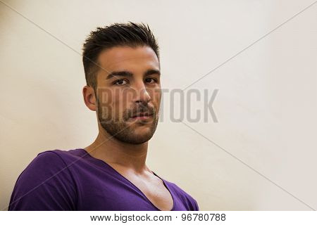 Handsome young man with purple t-shirt