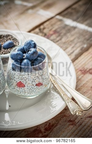 Milk Pudding With Chia Seeds And Fresh Berries For Breakfast In Portion Jars