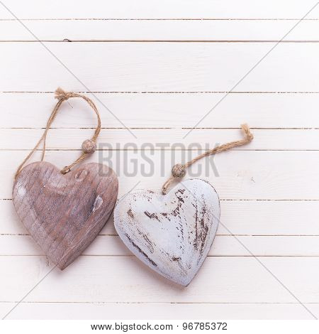 Two Decorative  Hearts On White  Painted Wooden Background