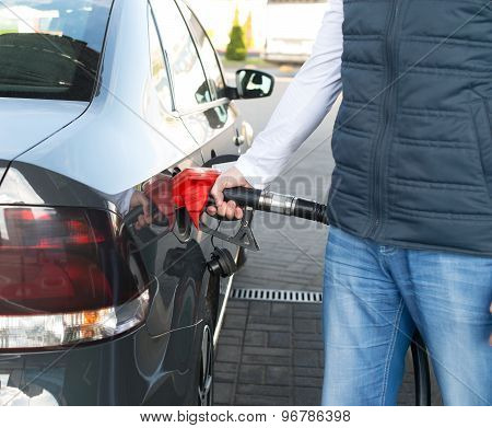 Man Refueling His Car In A Gas Station