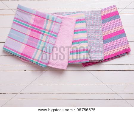 Pink  Kitchen Towels  On White Wooden Background.
