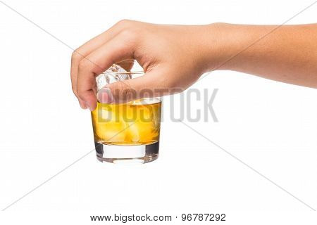 Hand holding a glass of whiskey on the rocks from the top