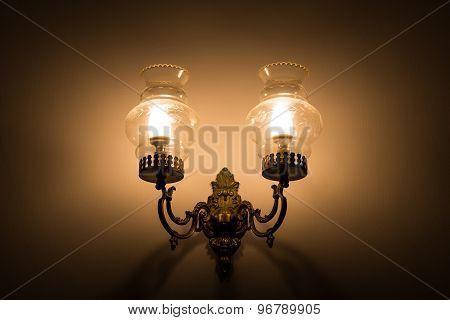 Old vintage wall lamp illuminate dark surrounding