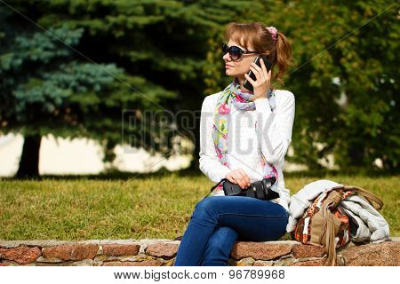 Girl With Camera Is Talking By Phone