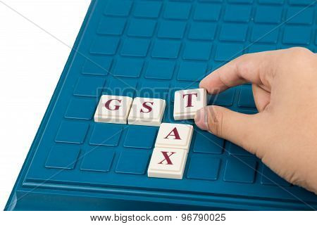 Goods and Services Tax concept. GST TAX alphabet letters on a board game.