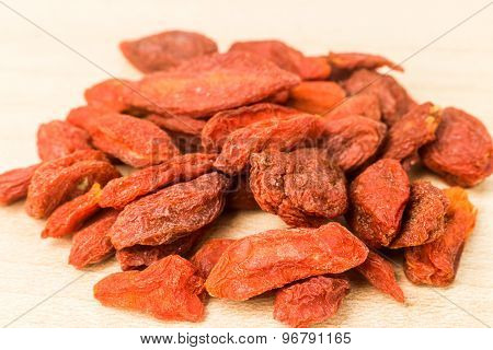 Heaps of dried wolfberry or goji on wooden background