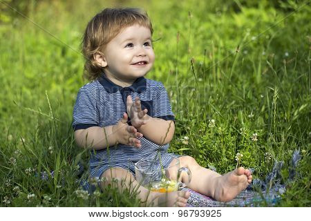 Playful Baby Boy On Grass