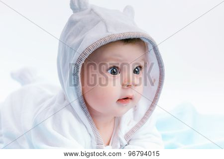 Baby In The Hood On A Blue Blanket