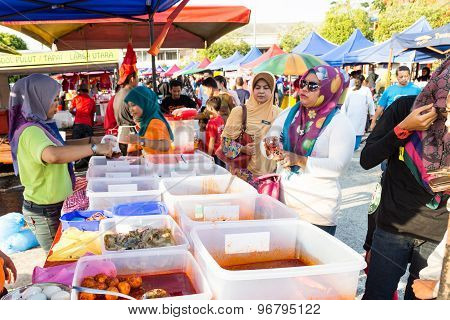 KUALA LUMPUR, MALAYSIA, JUNE 25 2015: Vendors selling cuisine at street bazaar catered for iftar or breaking fast during the Muslim fasting month of Ramadan. Fasting for 2016 scheduled to fall on June 6.