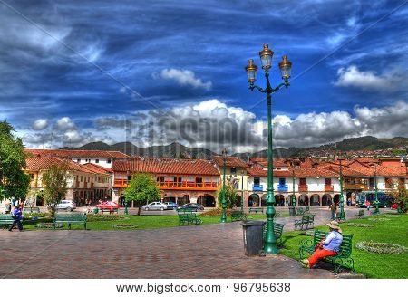 Morning at Plaza de armas Cusco Peru in High Dynamic Range (HDR) - a woman relaxing and viewing the