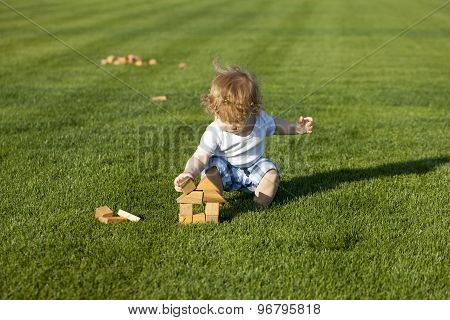 Little Baby Boy Builds A Wooden House