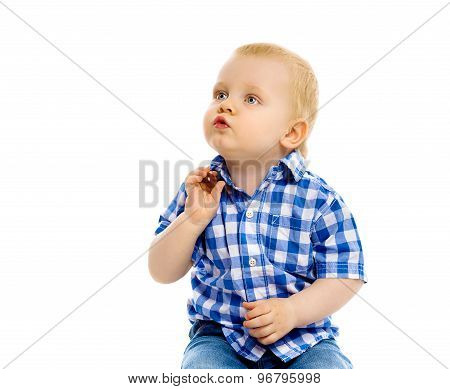 Little Boy In A Plaid Shirt And Jeans