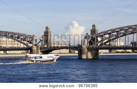 Meteor (boat) on the Neva River, against the background Bridge of Peter the Great (Bolsheokhtinsky).