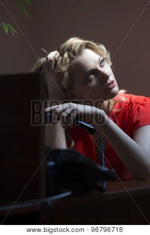 Pensive Female Secretary With Phone
