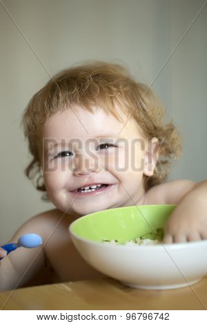 Portrait Of Little Laughing Boy Eating