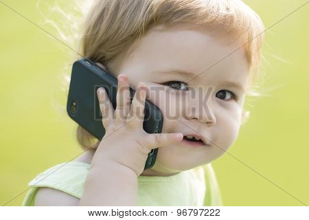 Small Baby Boy Speaking On Phone