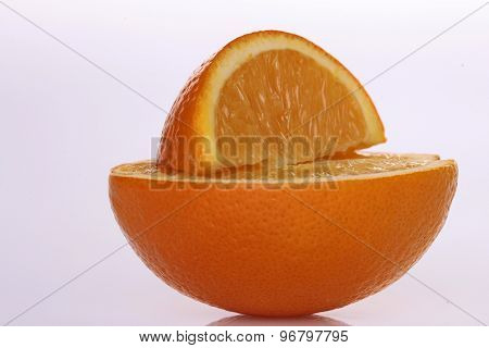 Half And Lobule Of Fresh Orange