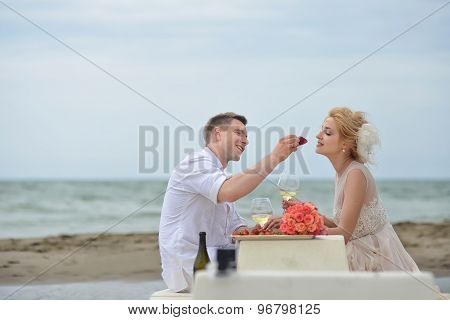 Wedding Couple Eating On Beach