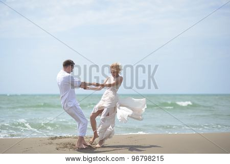Happy Wedding Couple On Beach