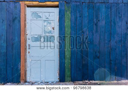 Old Wooden Light Blue Door In A Dark Blue Wall