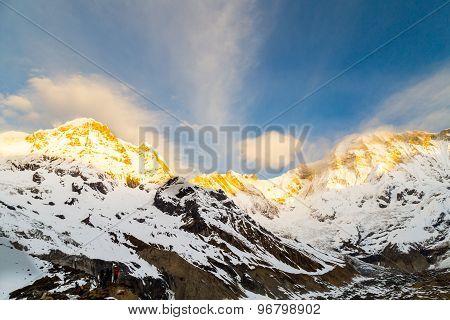 Sunrise rays on the peak of Annapurna South from Annapurna Base Camp, Nepal