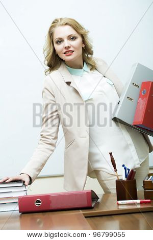 Attractive Woman Near Office Table