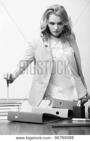 Serious Woman Near Office Table