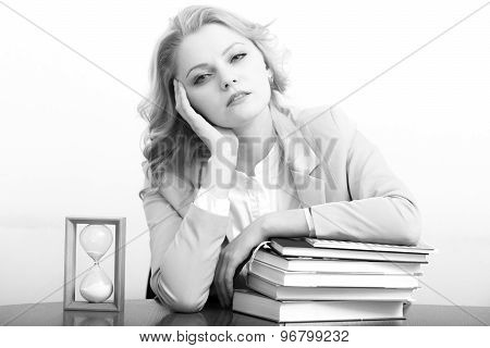Tired Woman With Books And Glass