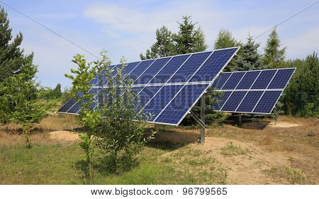 Two Photovoltaic Panels Set In Backyard