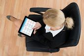 picture of employee month  - High Angle View Of Businesswoman Looking At Calendar On Digital Tablet In Office - JPG