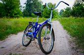 stock photo of dirt-bike  - Blue bike on a dirt road in the outdoors - JPG