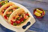 foto of poblano  - Camaron shrimp tacos mexican food on blue wood table - JPG