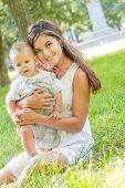 stock photo of mother baby nature  - happy young mother with child  - JPG