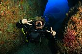 picture of cave woman  - Scuba diver having fun exploring reef and caves - JPG