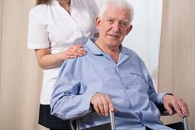 picture of pyjama  - Pensioner dressed in pyjama and sitting in a wheelchair - JPG