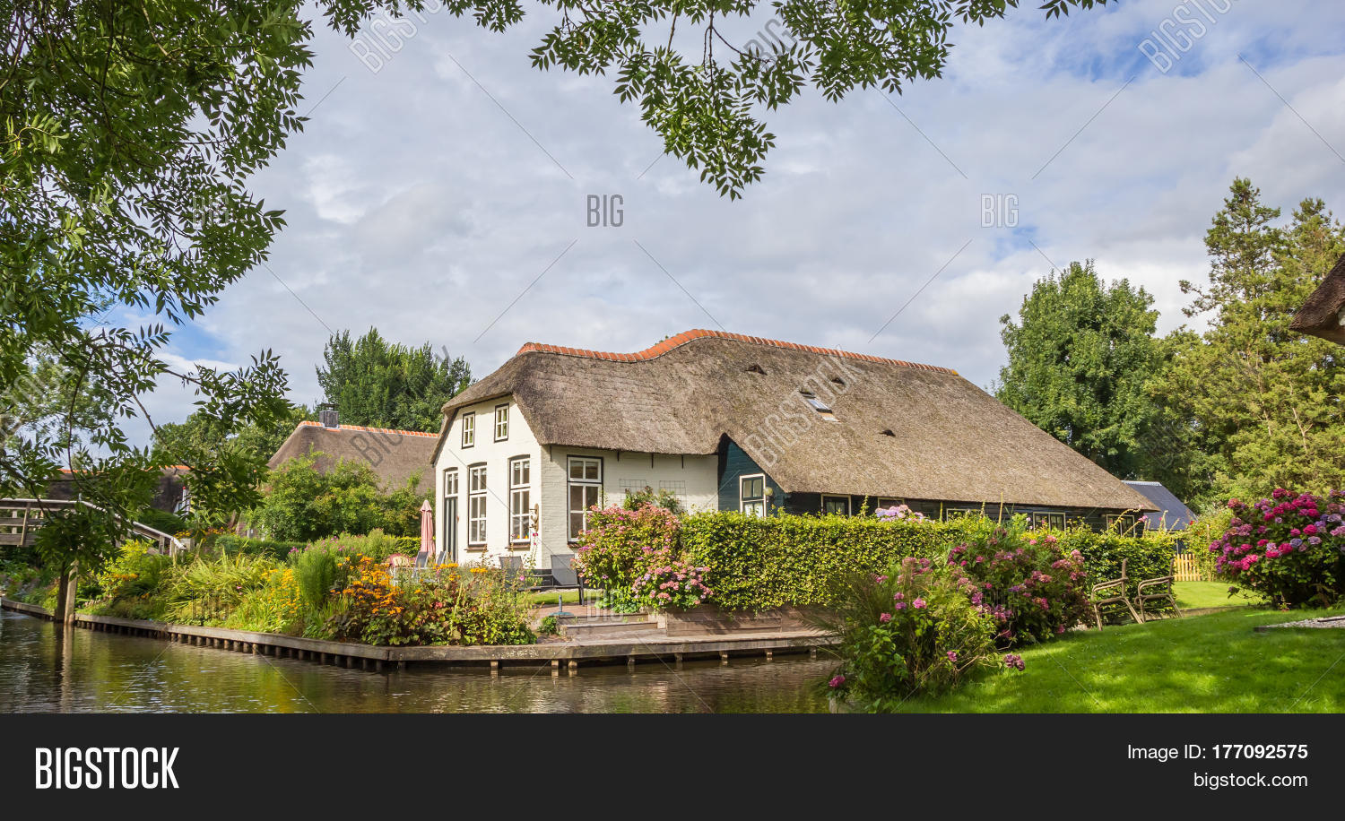 Panorama white farm house thatched image photo bigstock for Farm house netherlands