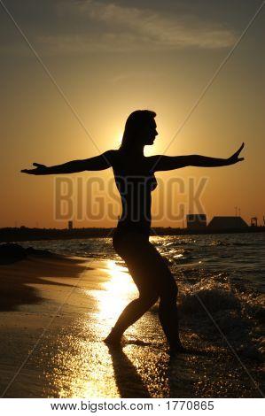Tai-Chi On A Beach