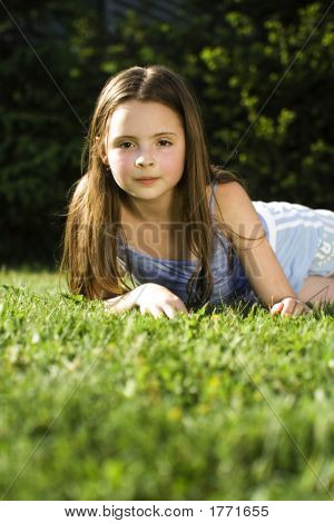 Young Girl Laying In Grass