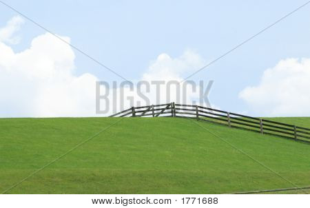 Green Dike With Blue Sky