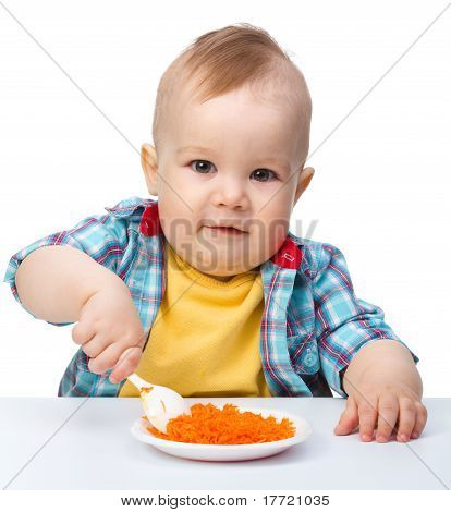 Cute Little Boy Is Playing With Carrot Salad