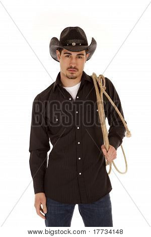 Cowboy Holding Rope Over Shoulder