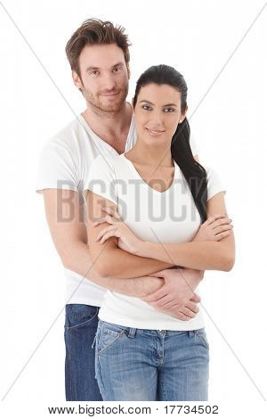 Portrait of attractive young couple smiling, hugging each other.?