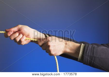 Hands Pulling On A Rope.
