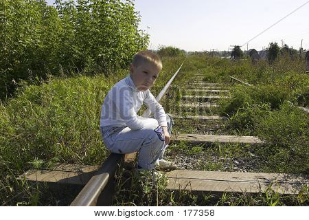 Boy And Railway