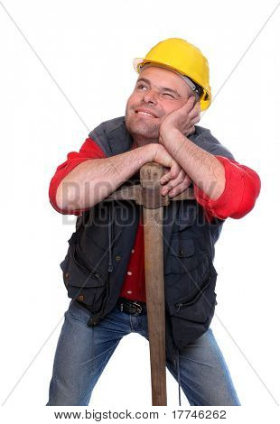 Happy construction worker resting on his pick axe. Insurance metaphor.